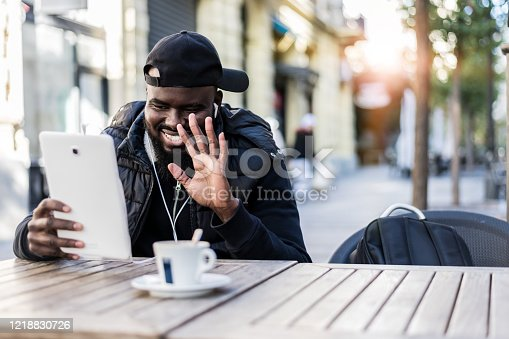 544356862 istock photo Handsome man sitting in coffee shop and using digital tablet 1218830726