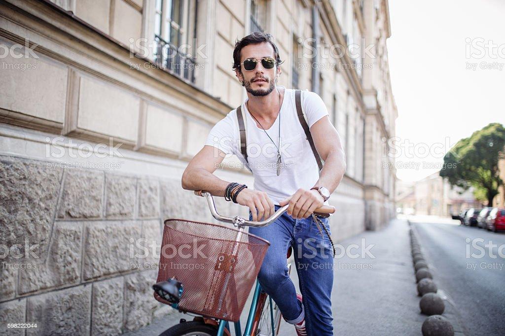 Handsome Man sitting on his Vintage Bike foto royalty-free