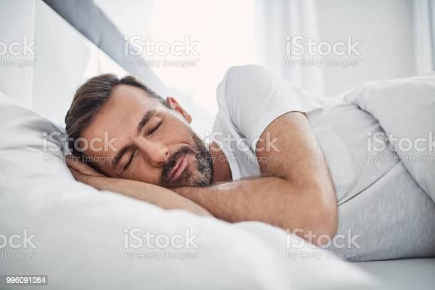 Handsome man sleeping in bed picture id996091084?b=1&k=6&m=996091084&s=612x612&h=6ihc8cmjjge50vbhnylaxz2vqheruypewkyq27wpdha=