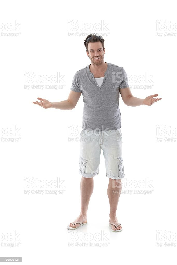 Handsome man smiling at summer stock photo