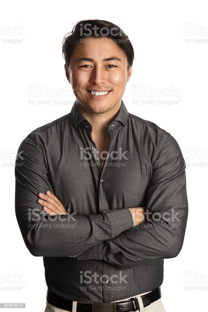 Handsome man smiling wearing grey shirt stock photo