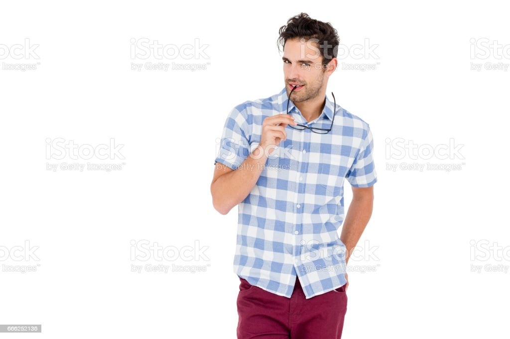 Handsome man standing holding spectacles stock photo