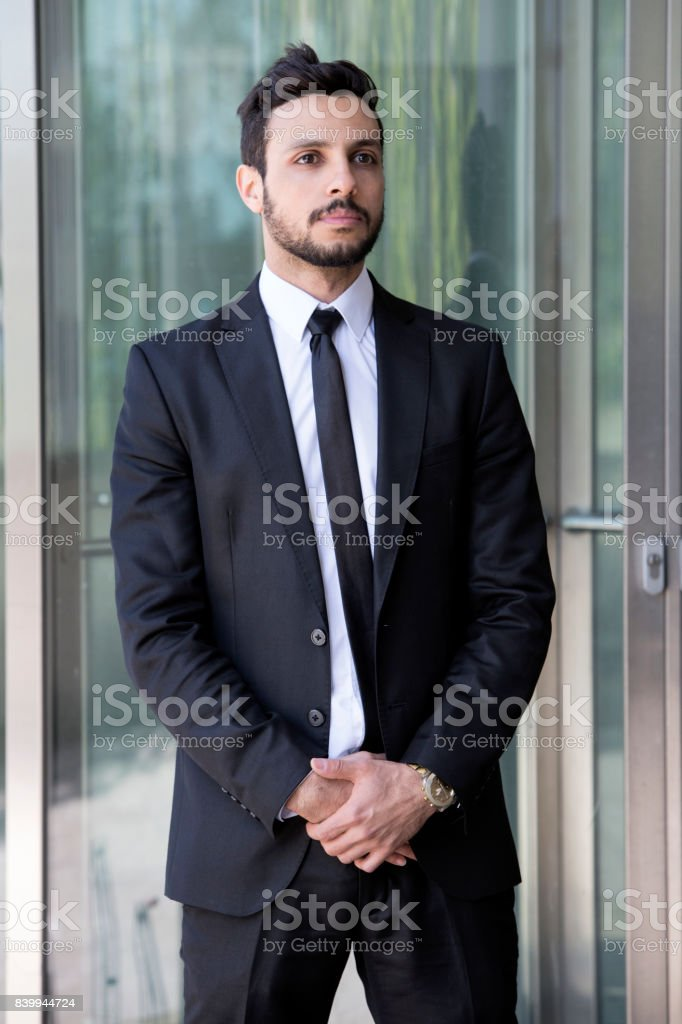 handsome man standing in a suit and tie stock photo