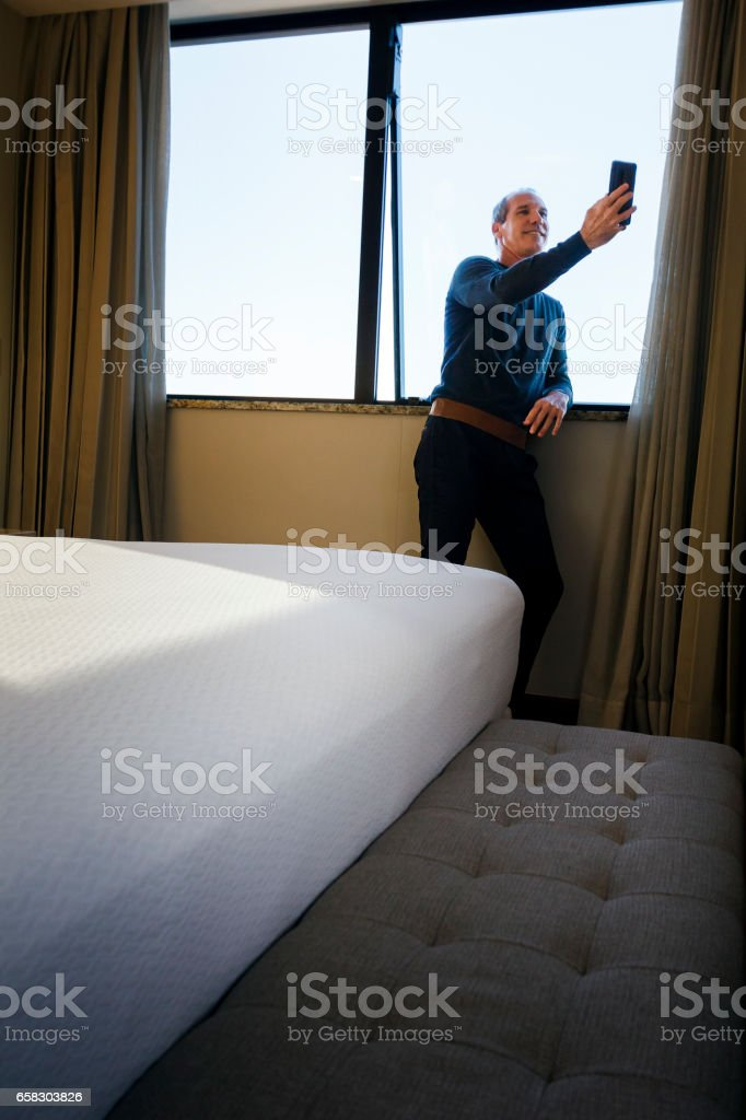 Handsome man taking a selfie stock photo