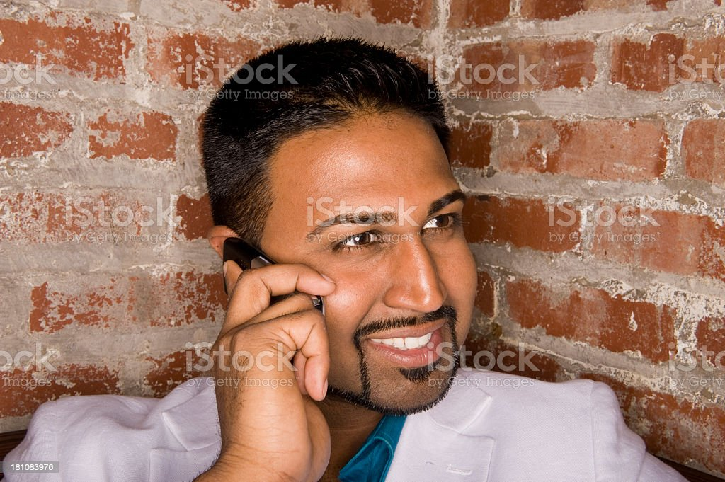 Handsome Man Talking On Cellphone royalty-free stock photo