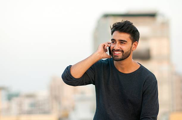 handsome man talking on mobile phone. - handsome people stock photos and pictures