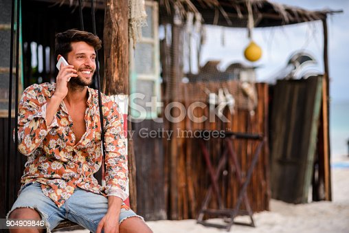 istock Handsome man talking on mobile phone 904909846