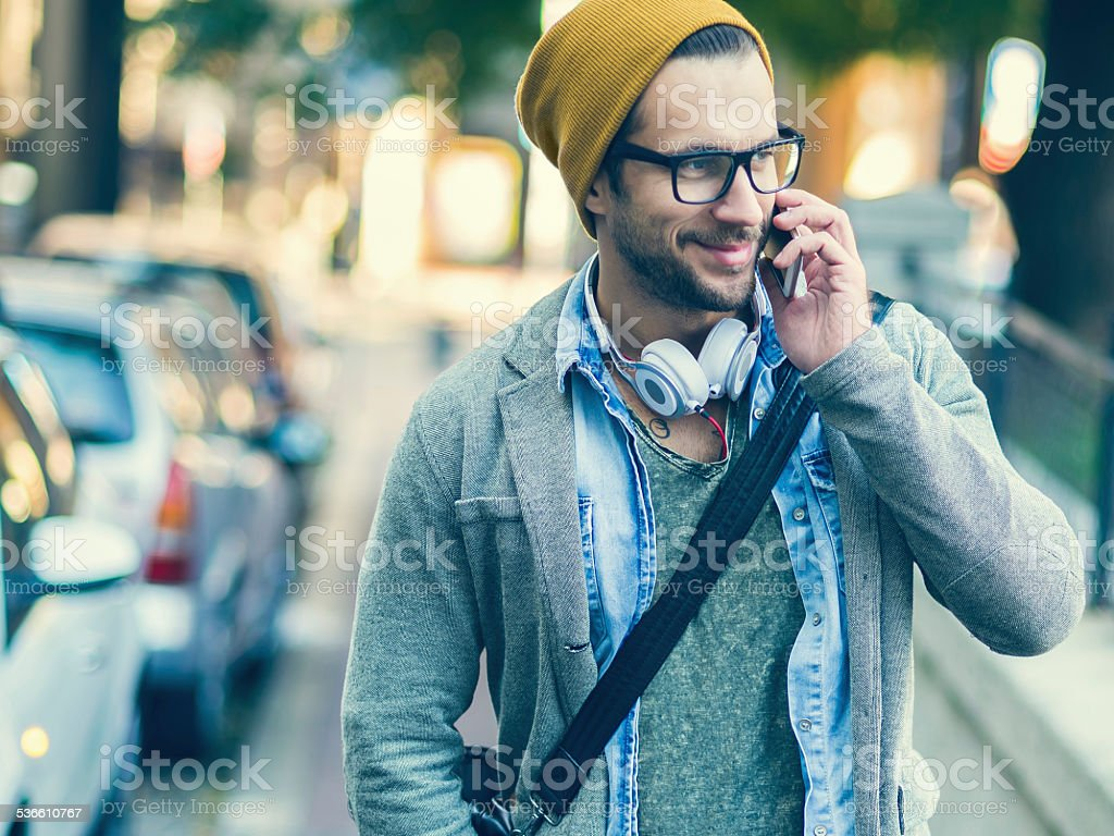 handsome man talking on the phone stock photo