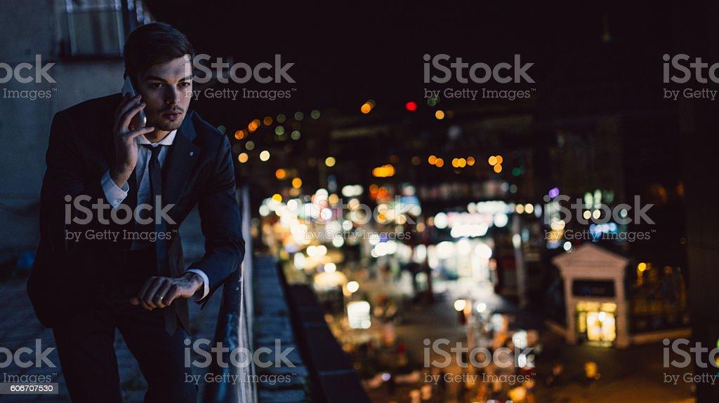 Handsome man talks on mobile - Photo