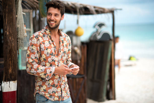 handsome man text messaging. - charming stock photos and pictures