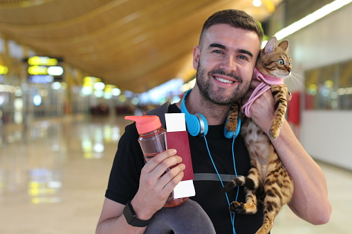 Handsome man traveling with his cat.