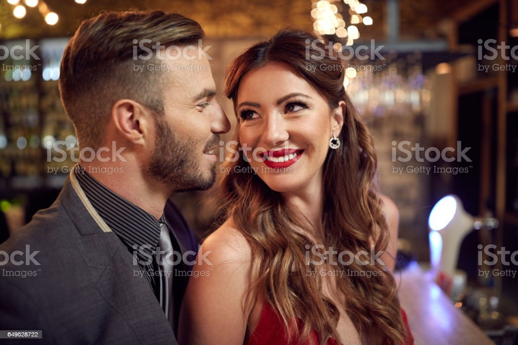 Handsome man try to win girls heart stock photo