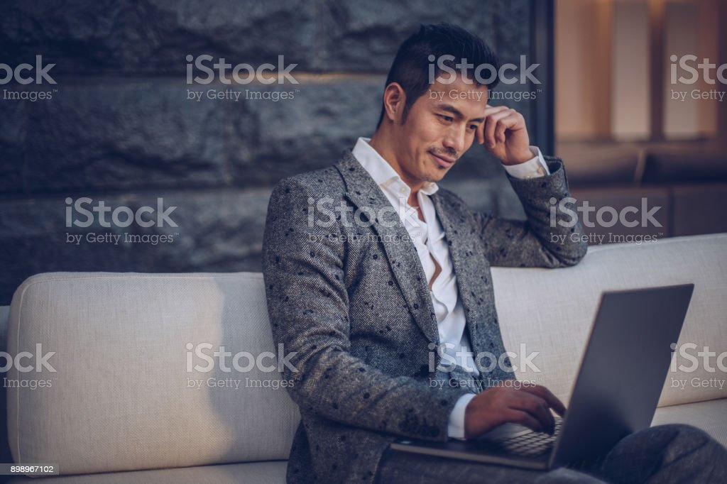 Handsome man using laptop stock photo