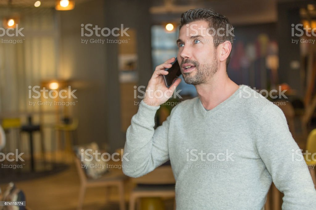 handsome man using smartphone royalty-free stock photo