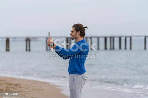 491496340 istock photo Handsome  man walking alone at the beach 678126332