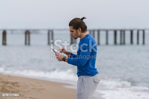 491496340 istock photo Handsome  man walking alone at the beach 678127064