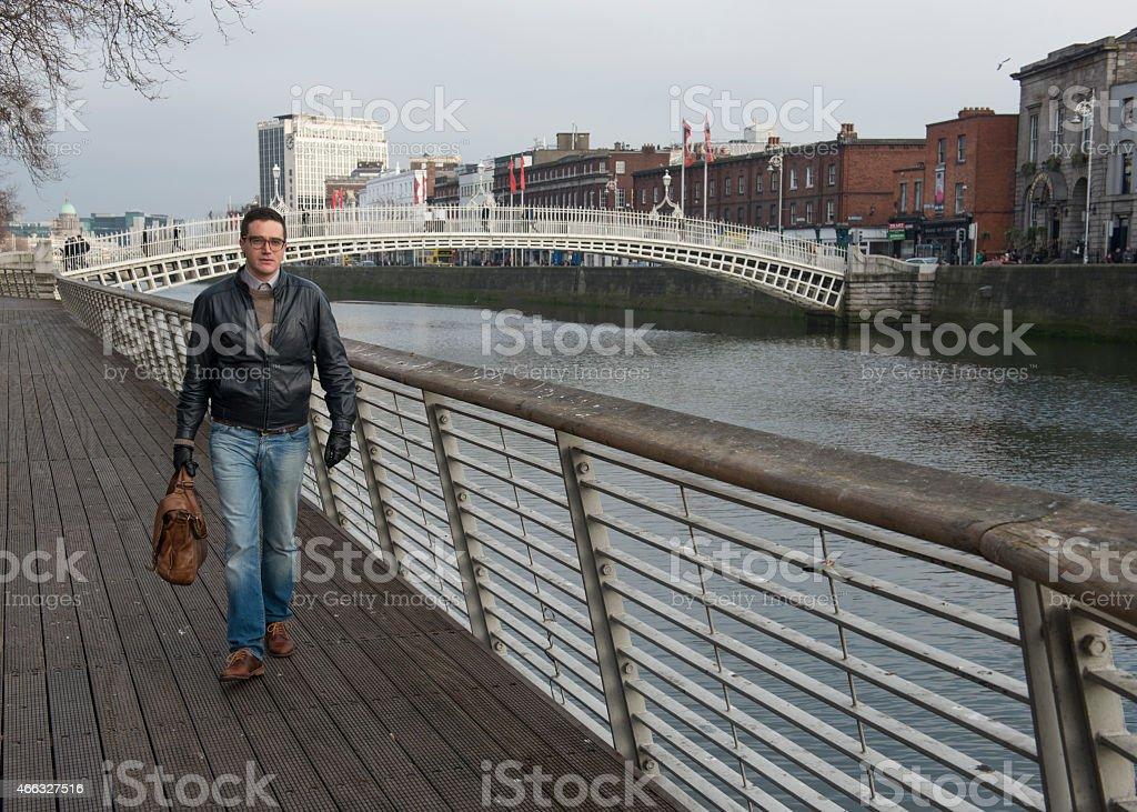 Handsome man walking in Dublin, Ireland. royalty-free stock photo