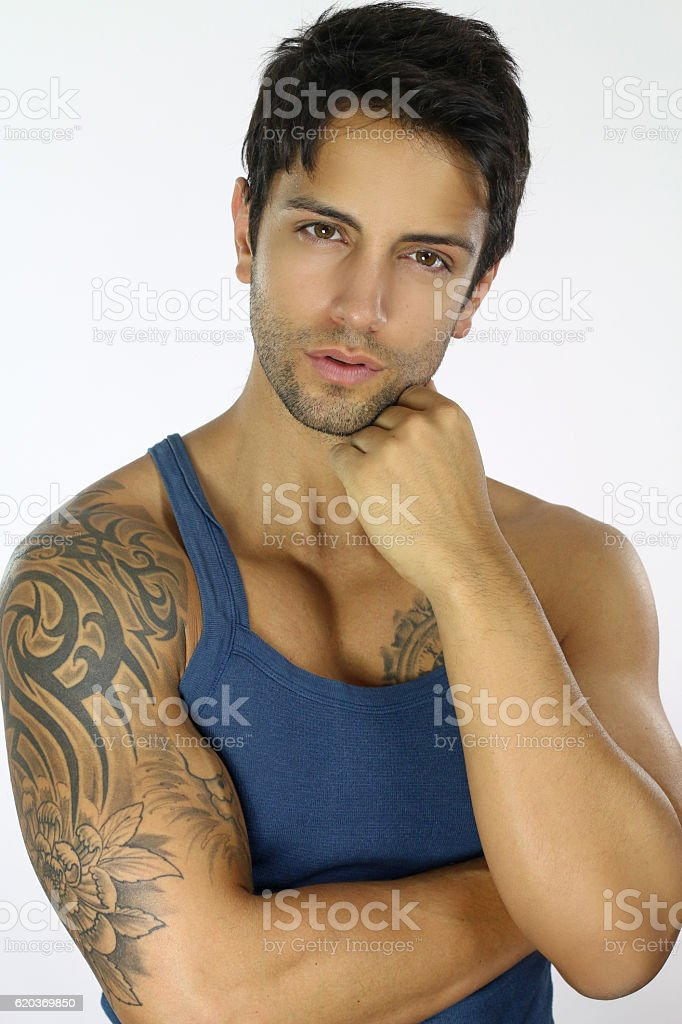 handsome man wearing a blue tank top zbiór zdjęć royalty-free