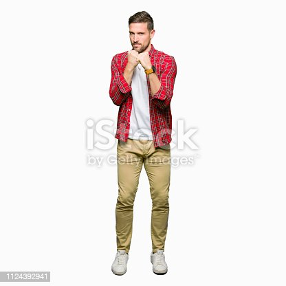 Handsome man wearing casual shirt Ready to fight with fist defense gesture, angry and upset face, afraid of problem