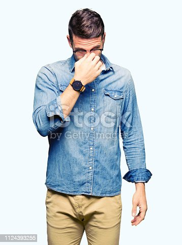 626964348istockphoto Handsome man wearing glasses tired rubbing nose and eyes feeling fatigue and headache. Stress and frustration concept. 1124393255