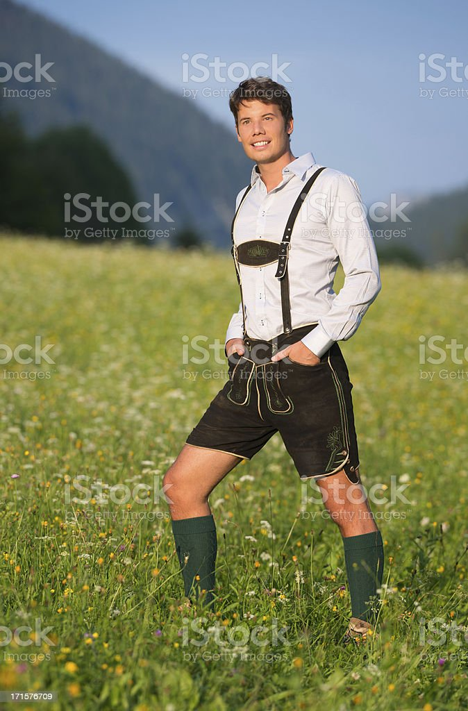 Handsome Man wearing Lederhosen, Austrian Alps (XXXL) stock photo