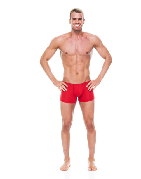 Handsome man with 6 pack wearing underwear - hands on hips Handsome man with 6 pack wearing underwear - hands on hips shirtless male models stock pictures, royalty-free photos & images