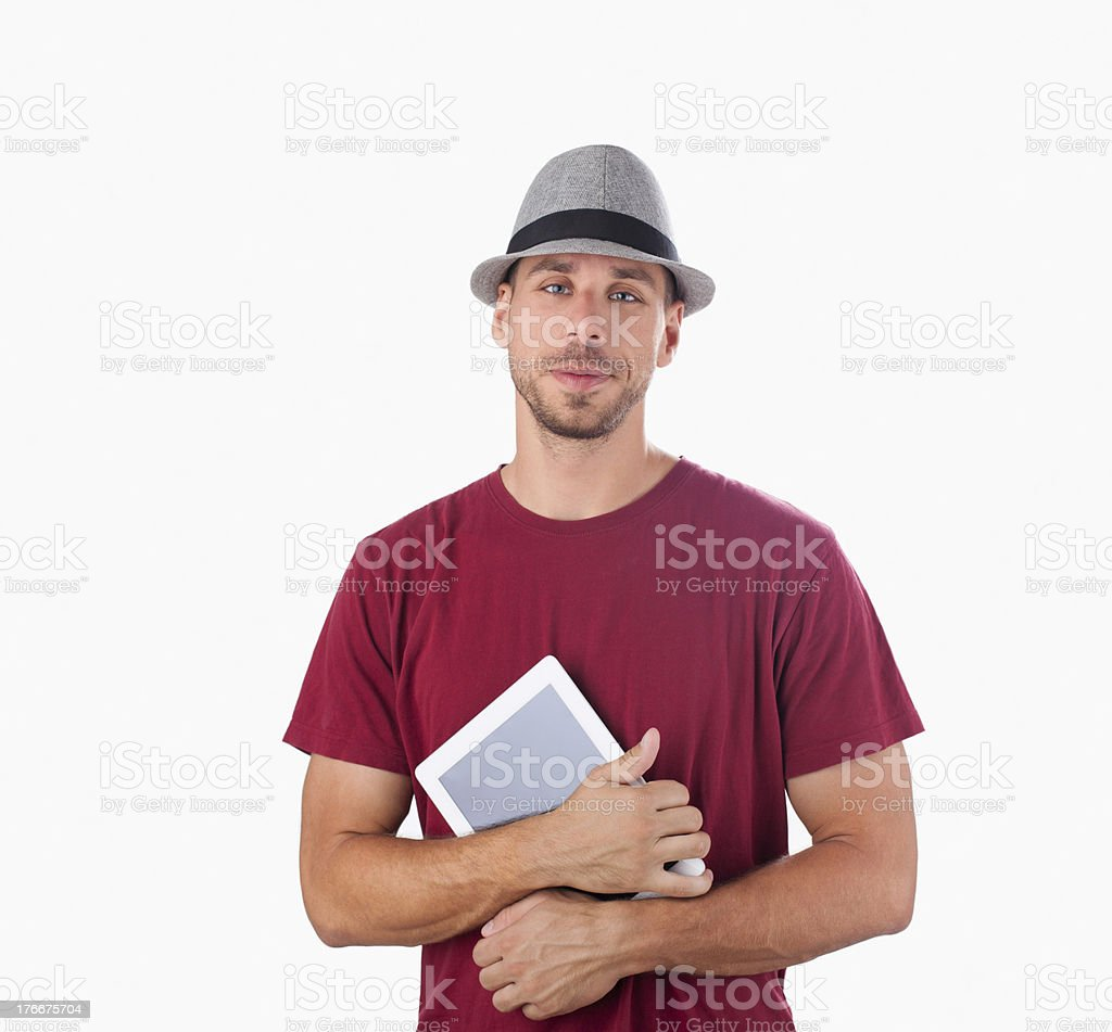 Handsome man with a hat, huging tablet PC royalty-free stock photo