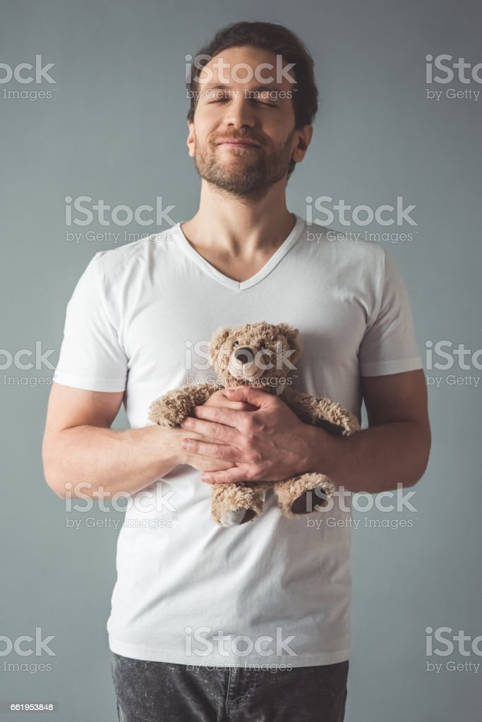 Handsome man with a toy royalty-free stock photo