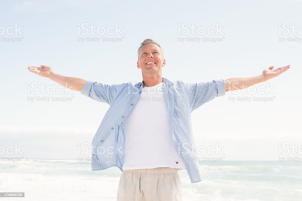 Handsome man with arms outstretched stock photo