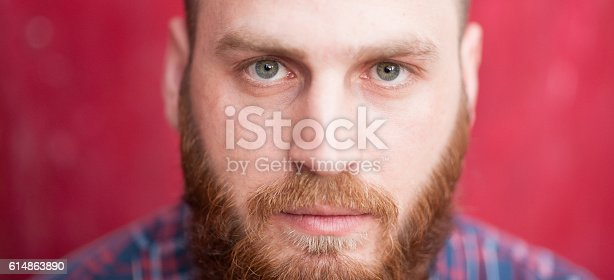 istock handsome man with beard looking at camera 614863890
