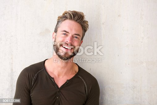istock Handsome man with beard smiling 506123386