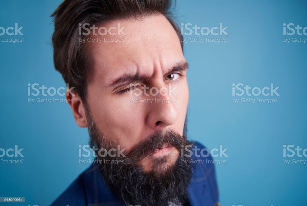 Handsome man with beard winking stock photo