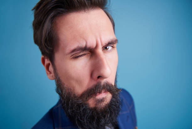 handsome man with beard winking - blinking stock pictures, royalty-free photos & images
