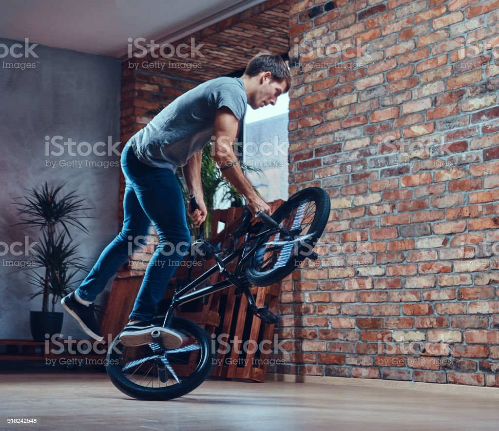 A handsome man with BMX in a studio. stock photo
