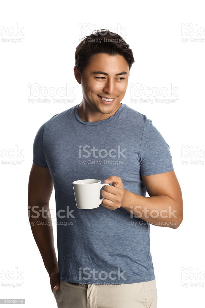 Handsome man with coffee cup looking away stock photo