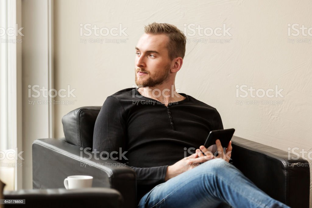 Handsome man with digital reader stock photo