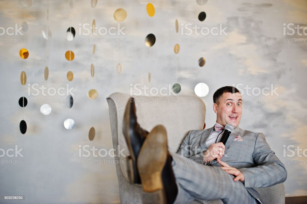 Handsome man with microphone stock photo