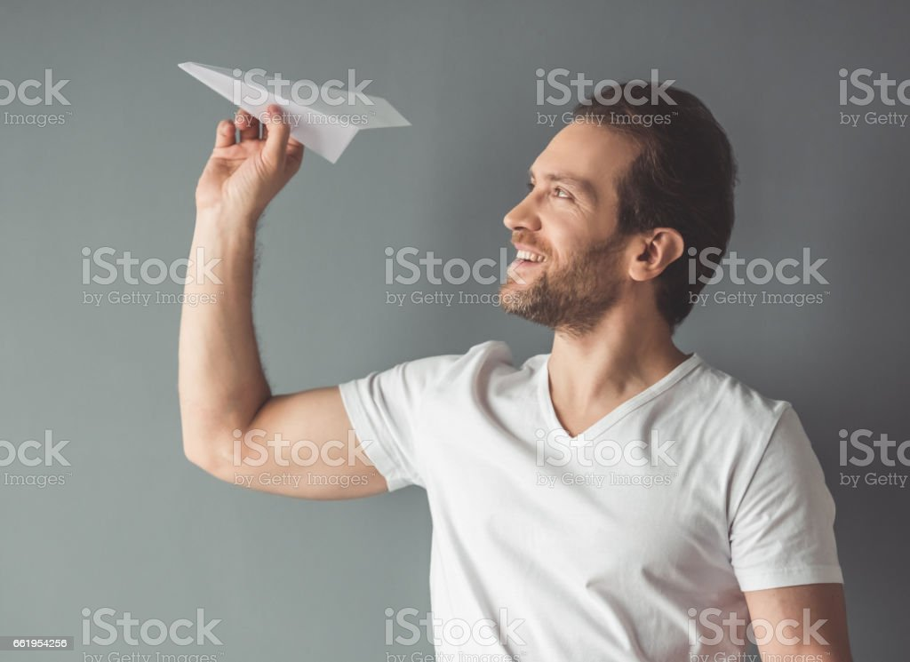 Handsome man with paper plane royalty-free stock photo