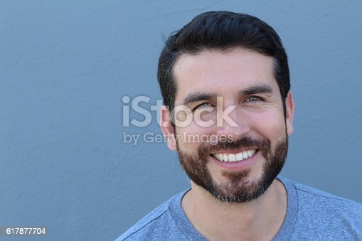 istock Handsome man with perfect white smile 617877704