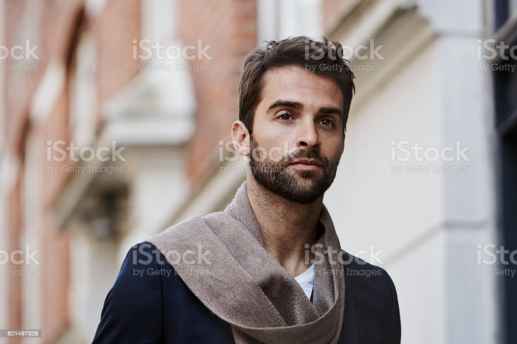 Handsome man with scarf in city, looking away foto stock royalty-free