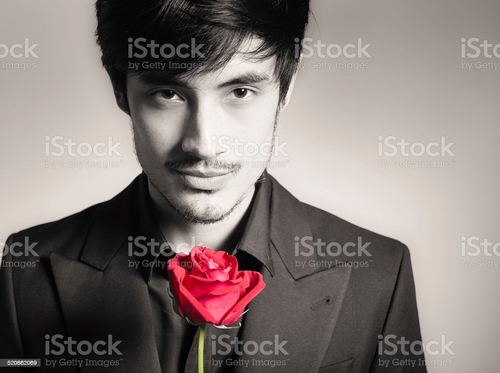 Handsome man with single rose stock photo