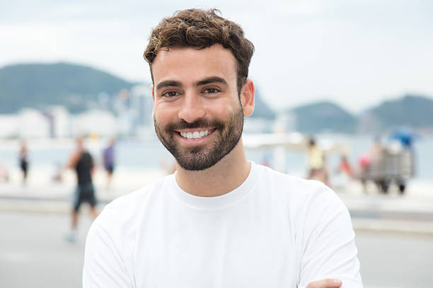 Handsome man with white shirt and beard in the city stock photo