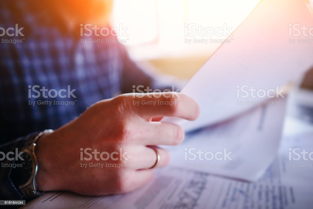 Handsome man working at home in the kitchen stock photo