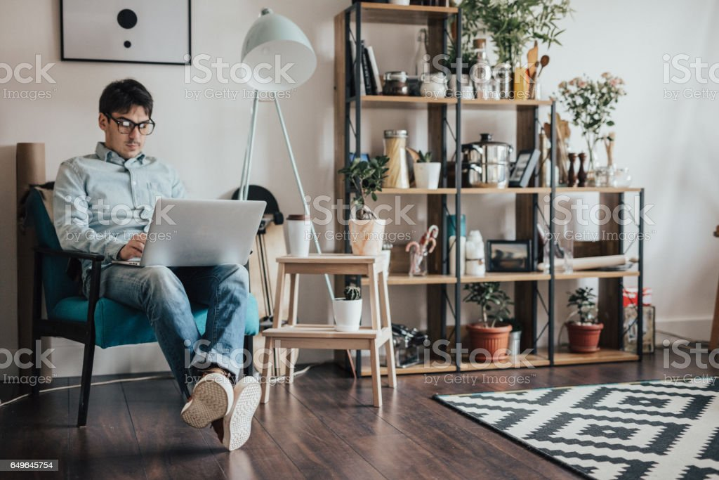 Handsome man working from home office stock photo