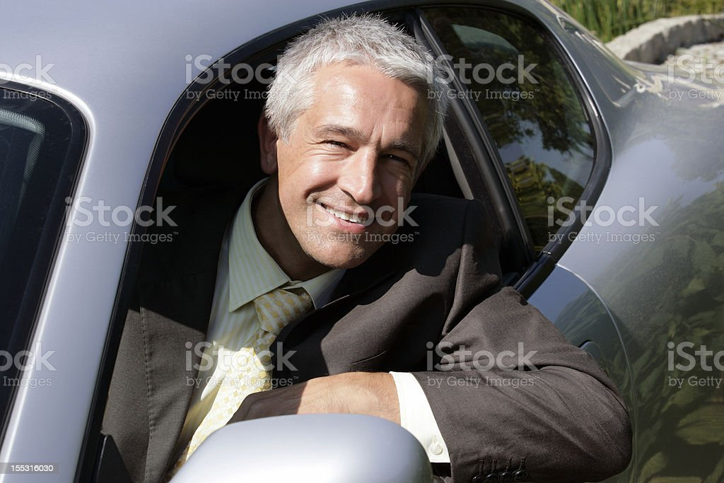 Handsome mature businessman in car royalty-free stock photo