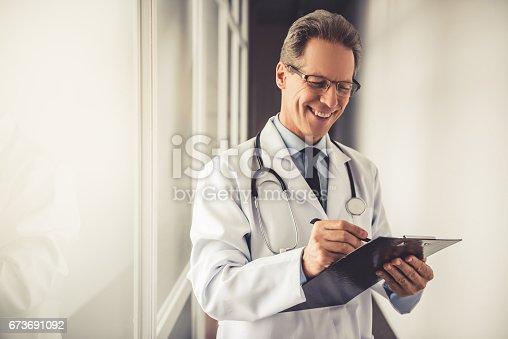 istock Handsome mature doctor 673691092