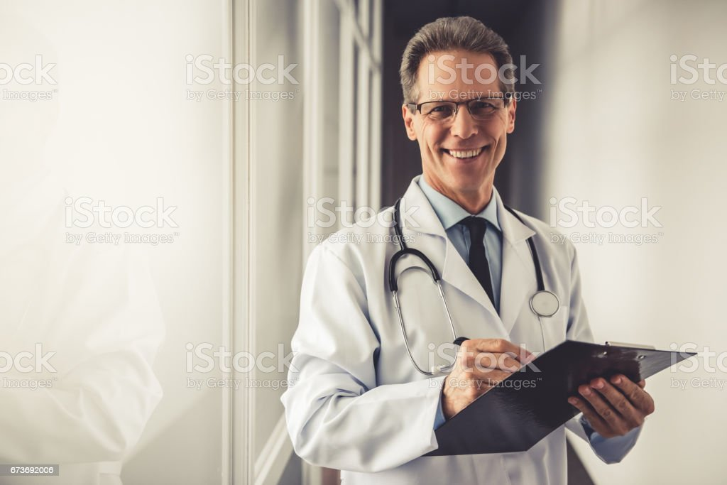 Handsome mature doctor stock photo