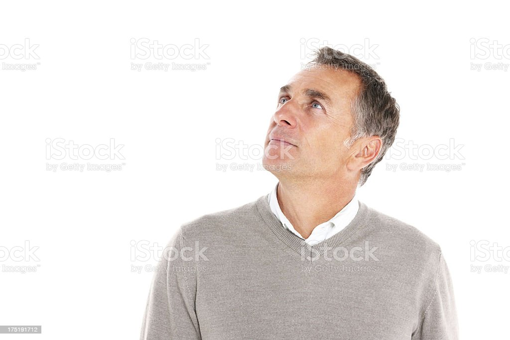 Handsome mature guy looking up at copyspace royalty-free stock photo
