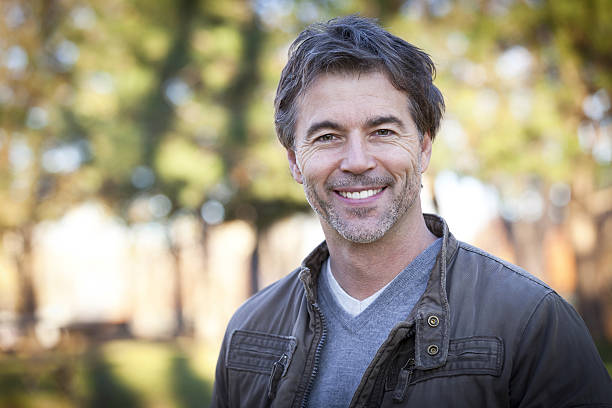 Handsome Mature Happy Man Smiling At The Camera.Outside. stock photo