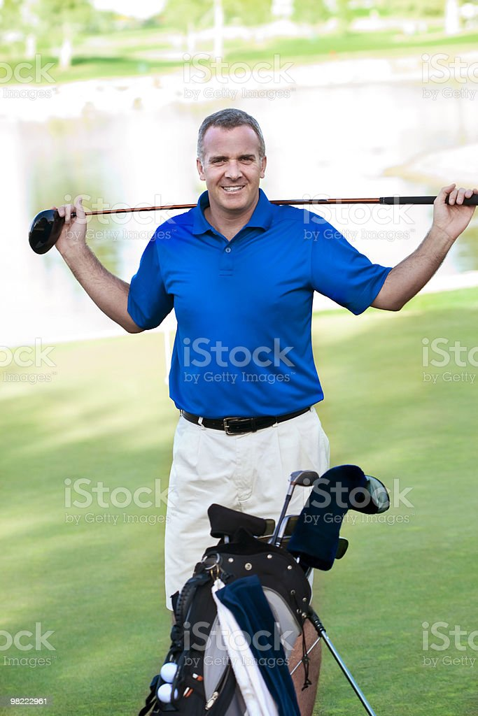 Handsome Mature Male on the Golf Course royalty-free stock photo